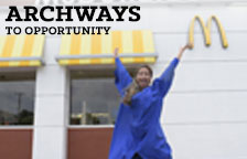 Archway to Opportunities graduate jumping into the air