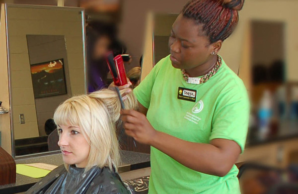 Student getting hair styled at Transitions School of Cosmetology