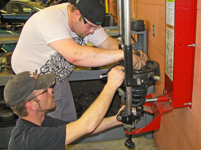 Students working spring compressor