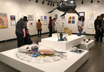 Patrons viewing student work in the Fine Arts Gallery