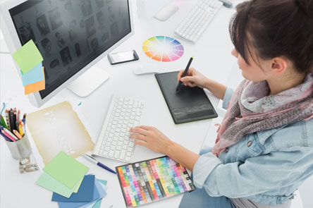 women designing  on computer and tablet