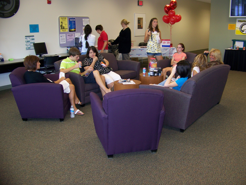 students hanging out in lounge area before class