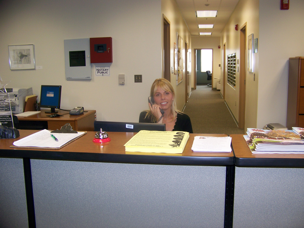 staff person at Northern Tier Center answering phone