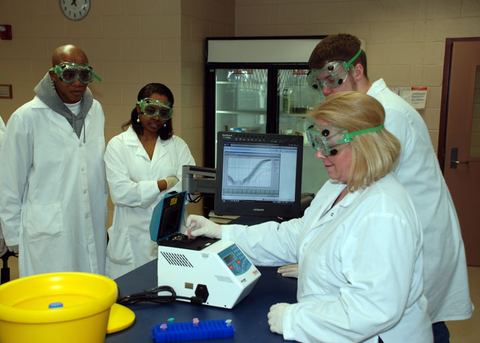 Students in protective clothing separating fluids