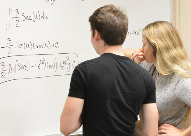 Two student working on advanced math problem