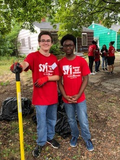 Group of Teens in SYI program doing outdoor clean up project