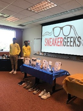Photo of Teen participants presenting business model Sneakergeeks